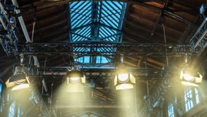 spotlight on the ceiling of a former factory hall for lighting during a concert