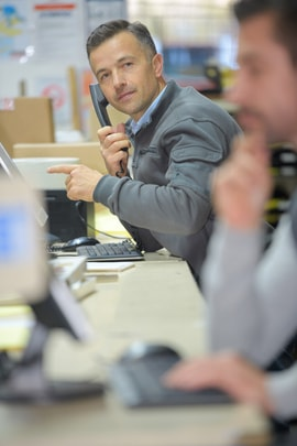worker in a call center office talking on the phone